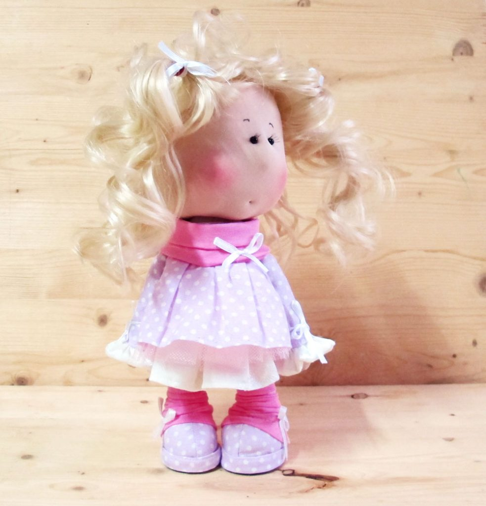 doll with white hair and pink dress
